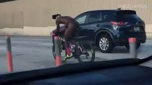 Nothing Scripted – Naked Man Rides Bike on -i95